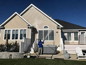 WHOLE HOUSE VINYL, TRIM, WINDOW FRAMES AND  EXTERIOR GUTTERS CLEANED!