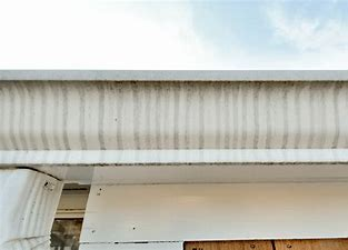 OUR GUTTER BRIGHTENING SERVICE REMOVES THESE TIGER STRIPES.